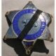 A Los Angeles County Sheriff's Deputy badge with mourning ribbon
